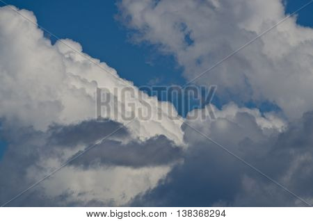 Billowing Cumulus Clouds Boiling in the Bright Blue Summer Sky