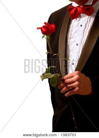 Man In Tuxedo With Rose