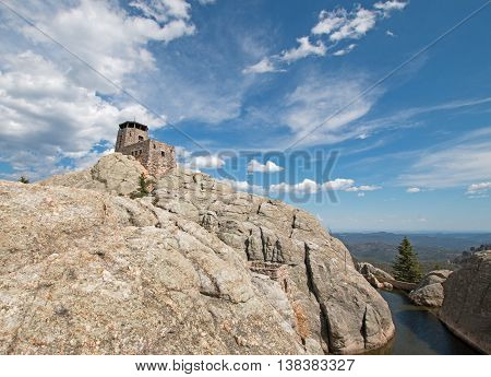 Harney Peak Fire Lookout Tower and pump house with small dam in Custer State Park in the Black Hills of South Dakota  United States