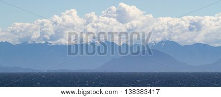 This is a photo of Canadian mountains and the Pacific Ocean taken just west of Vancouver.