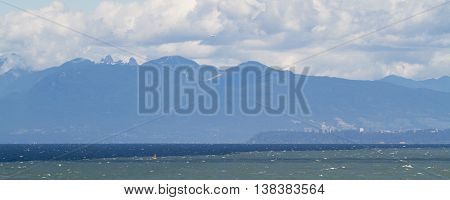 This photo looks north towards the north shore mountains of Vancouver B.C.  It was taken from the Pacific Ocean.