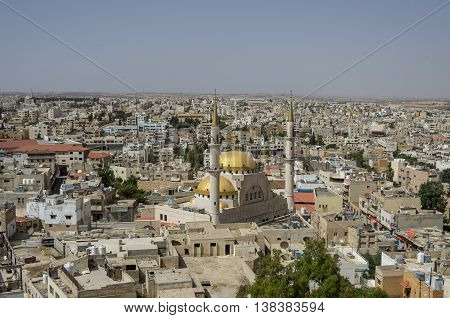Madaba, Jordan - June 3, 2016: Panoramic view over the town center of Madaba in Jordan with the Central Mosque