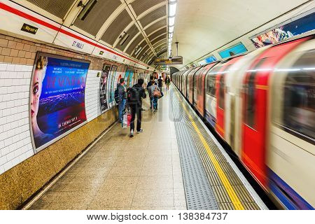 London UK - June 19 2016: platform of an underground station with unidentified people in London. The London Underground is the oldest underground of the world.