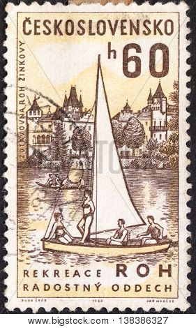 MOSCOW RUSSIA - JANUARY 2016: a post stamp printed in CZECHOSLOVAKIA shows Zinkovy Sanatorium and Sailing Dinghy the series