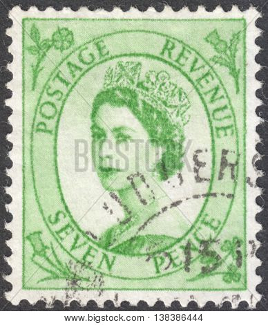MOSCOW RUSSIA - JANUARY 2016: a post stamp printed in the UNITED KINDOM shows a Portrait of Queen Elizabeth II circa 1952
