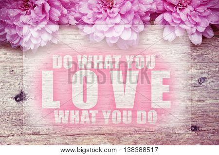 pink flowers on wooden with word Do what you love love what you do