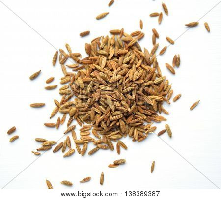 Cumin (cuminum cyminum from apiaceae family) in a pile isolated on white background