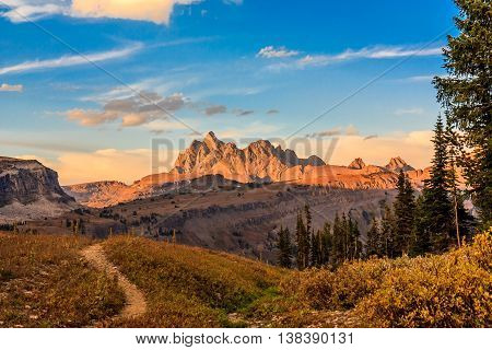 Morning on the trail with mountains in the background in Grand Teton National Park