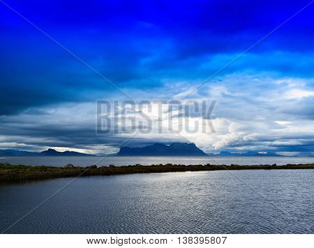 Horizontal Vivid Norway Fjord Ocean Bay With Dramatic Clouds Bac