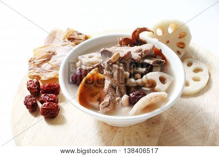 Chinese traditional Pork rib soup with Lotus root, dried squid and red dates