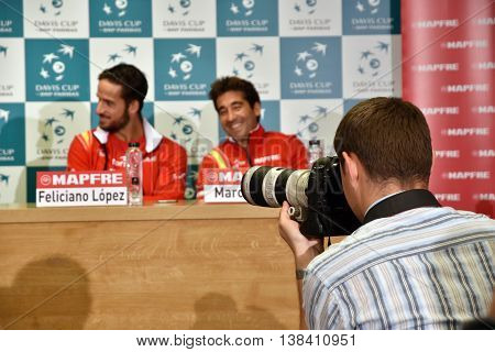 Photojournalist Photographing Tennis Press Conference