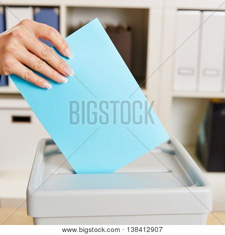 Hand with ballot paper for voting in an federal election