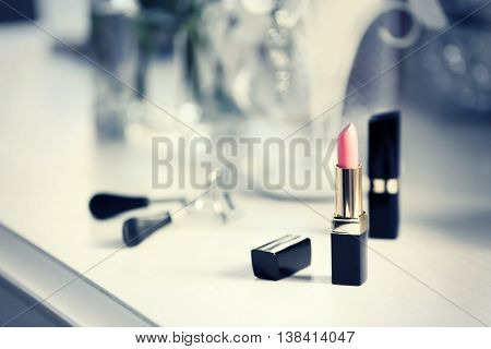 Lipstick on light dressing table, close up
