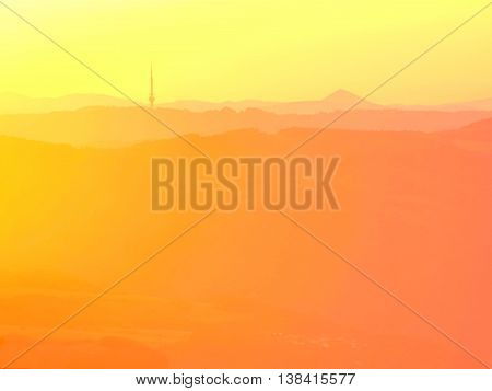 Magnificent heavy mist in landscape. Autumn fogy sunrise in a countryside. Hill increased from fog, the fog is colored to golden and orange.