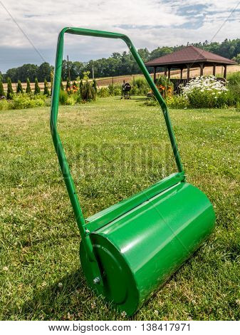 Green lawn roller ready to roll the garden lawn