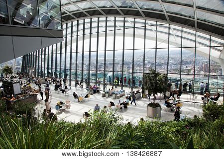 LONDON, UK - JUNE 28, 2016: The Sky Garden at 20 Fenchurch Street is a unique public space designed by Rafael Vinoly Architects. It features a stylish restaurant; brasserie and cocktail bar
