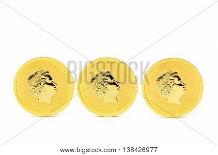 Three standing dollar gold coins isolated on white background