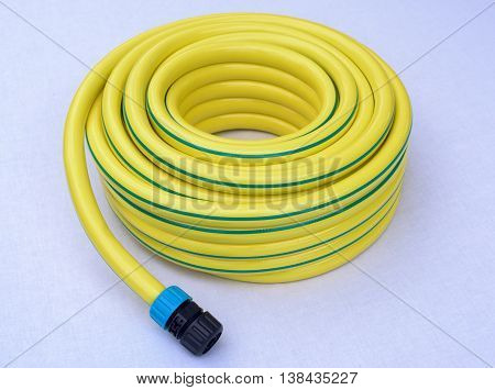 Hose-pipe with couplung on a white background