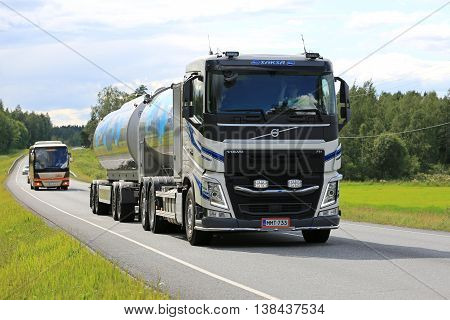 TAMMELA, FINLAND - JULY 9, 2016: New Volvo FH milk tanker transports Valio milk on scenic summer road in South of Finland. The usual temperature of transported milk is 3 degrees Celsius.