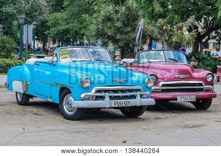 HAVANA, CUBA - MARCH 17, 2016: Old cars parking near Central Park in Havana the capital of Cuba