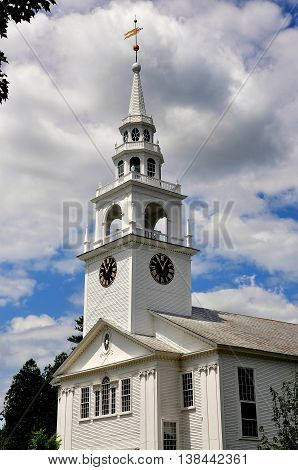 Hancock New Hampshire - July 11 2013: First Congregational Church built in white clapboard colonial New England style with a tiered steeple and belltower holding Paul Revere's Bell