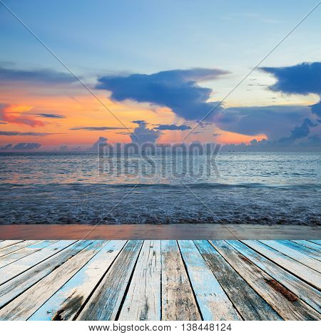 Wood floor on landscape with sunset over sea scenery background