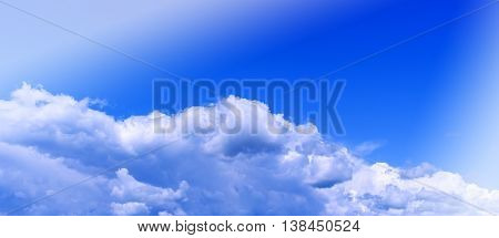 Horizontal vivid wide pano bottom aligned cloudscape compostion with light background backdrop