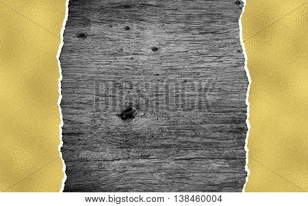 black wooden background with golden torn paper and copy space