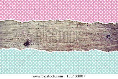 wooden background with polka dot torn paper and copy space