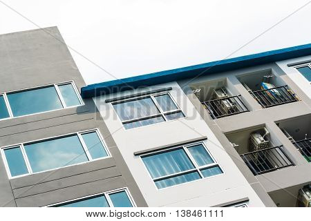 Apartment Building Low Rise Close Up On White Cloud