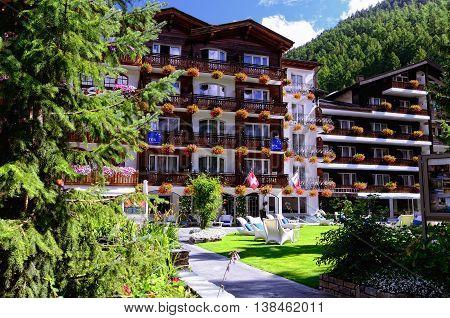 ZERMATT, SWITZERLAND - AUGUST 31, 2014: 4 Star Hotel Rex on August 31, 2014 in Zermatt, Switzerland. Zermatt is a Mountain Resort Town in Southern Switzerland.