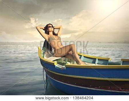 Sunbathing on a little boat