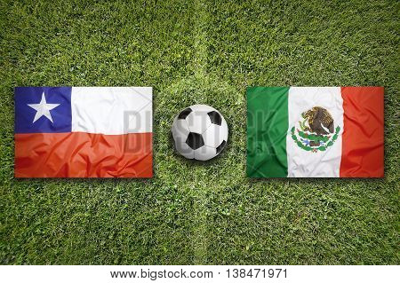 Chile Vs. Mexico Flags On Soccer Field