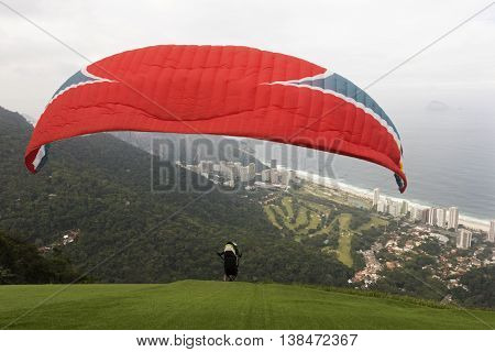 Para-glider taking off from Pedra Bonita ramp in Tijuca Forest National Park, Rio de Janeiro, Brazil