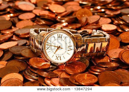 A watch on a pile of pennies