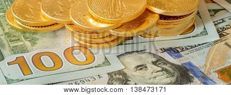 Gold Coins Stacked On New Design 100 Dollar Bills