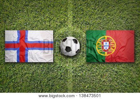 Faeroe Islands Vs. Portugal Flags On Soccer Field