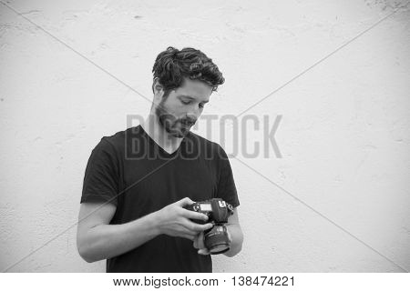portrait of a cool dude checking photos