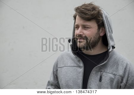 portrait of a cool dude with a hoodie