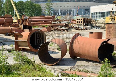Scrap metal lies at the construction.There is an iron pipecut with a blowtorch.
