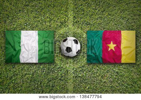 Nigeria Vs. Cameroon Flags On Soccer Field