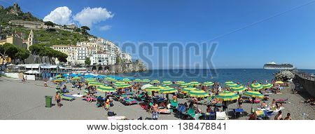 AMALFI ITALY - JUNE 27: Beach Panorama in Amalfi on JUNE 26 2014. People at Sandy Beach in Amalfi Italy.