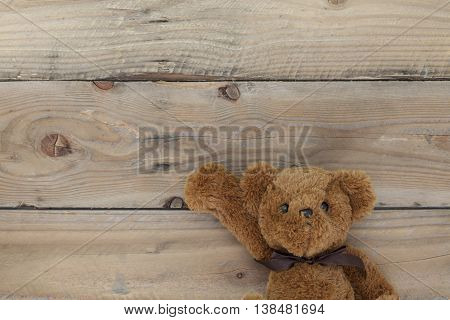 Teddy bear on a old wood background