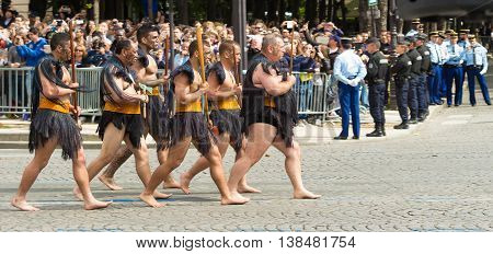 Paris France-July 14 2016 : The Maori warriors participate in Bastille Day military parade on Champs Elysees avenue on the occasion of the centennial anniversary of the Battle of Somme during 1st World War.
