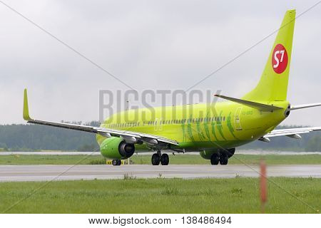 MOSCOW, RUSSIA - MAY 19, 2016: Aircraft Boeing737 S7 Airlines taxiing. Plane makes taxiing on taxiway Domodedovo International Airport.