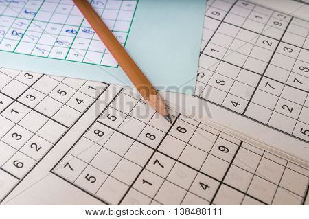 Pencil and many sudoku crosswords - popular puzzle game.