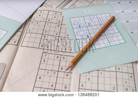 Pencil And Sudoku Crosswords. Puzzle Game With Numbers.