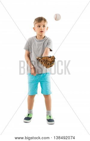 Cute Little Boy Trying To Catch Baseball In His Glove Over White Background