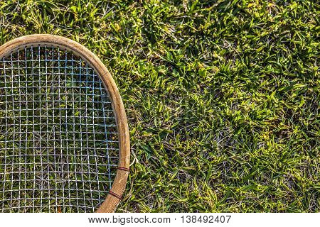 Vintage Wood Tennis Racket On Green Grass Garden