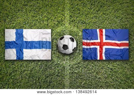 Finland Vs. Iceland Flags On Soccer Field